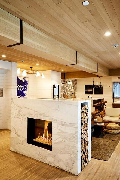 75x65 Tunnel 2 Fireplace Divides Two Gathering Spaces