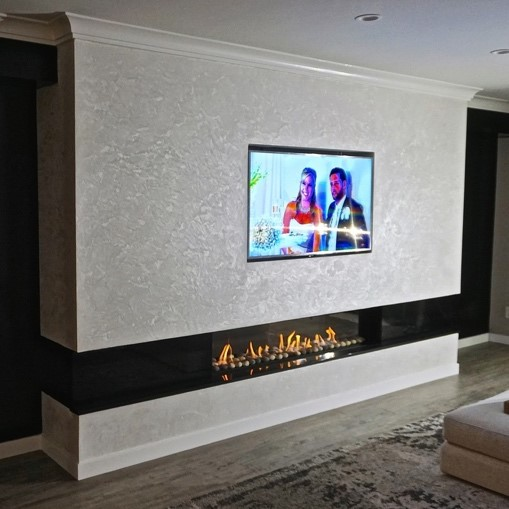 CK Construction photo with an Ortal Fireplace